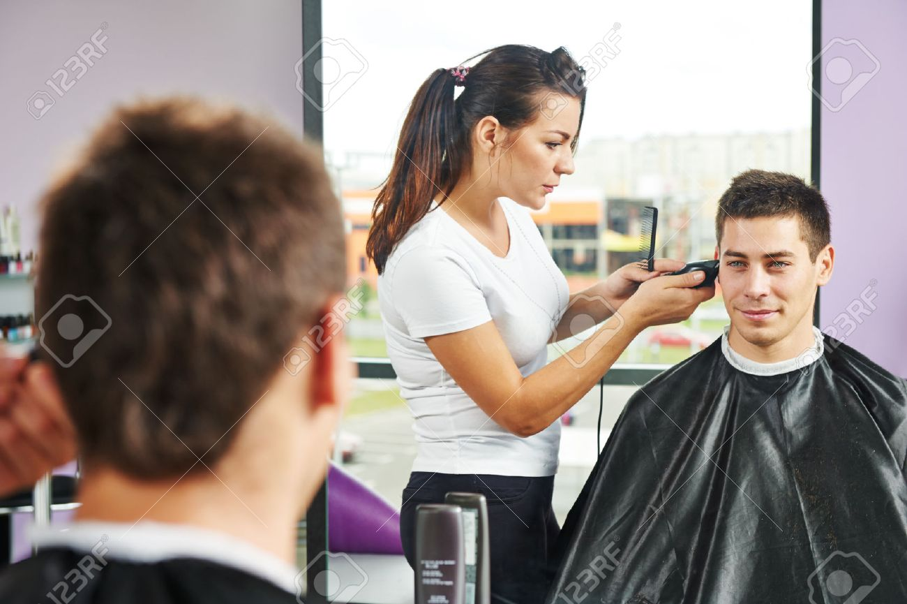 Female hairdresser cutting hair of smiling man client at beauty parlour Stock Photo - 22801821