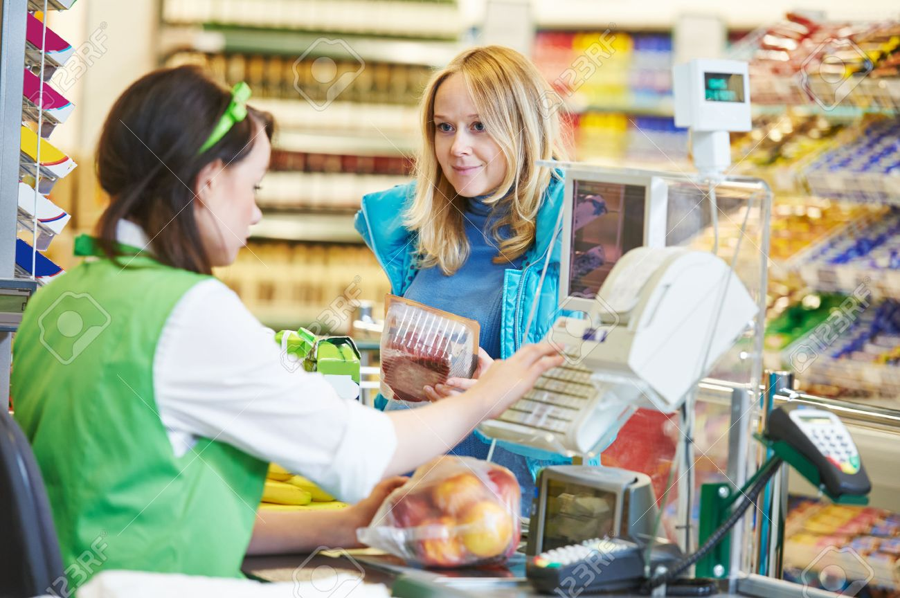 Customer Buying Food At Supermarket And Making Check Out With ...