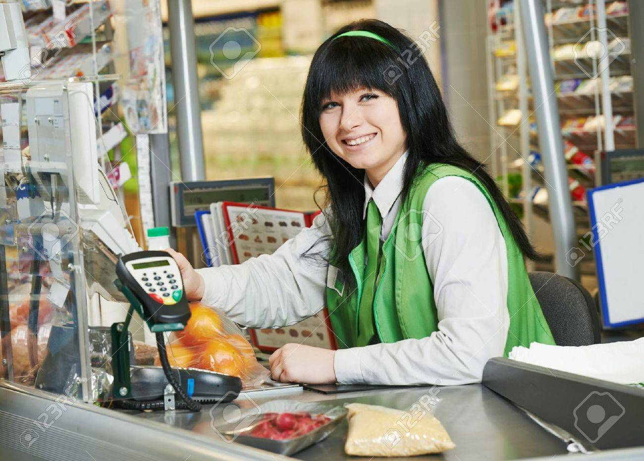 portrait of s assistant or cashdesk worker in supermarket portrait of s assistant or cashdesk worker in supermarket store stock photo 27914042