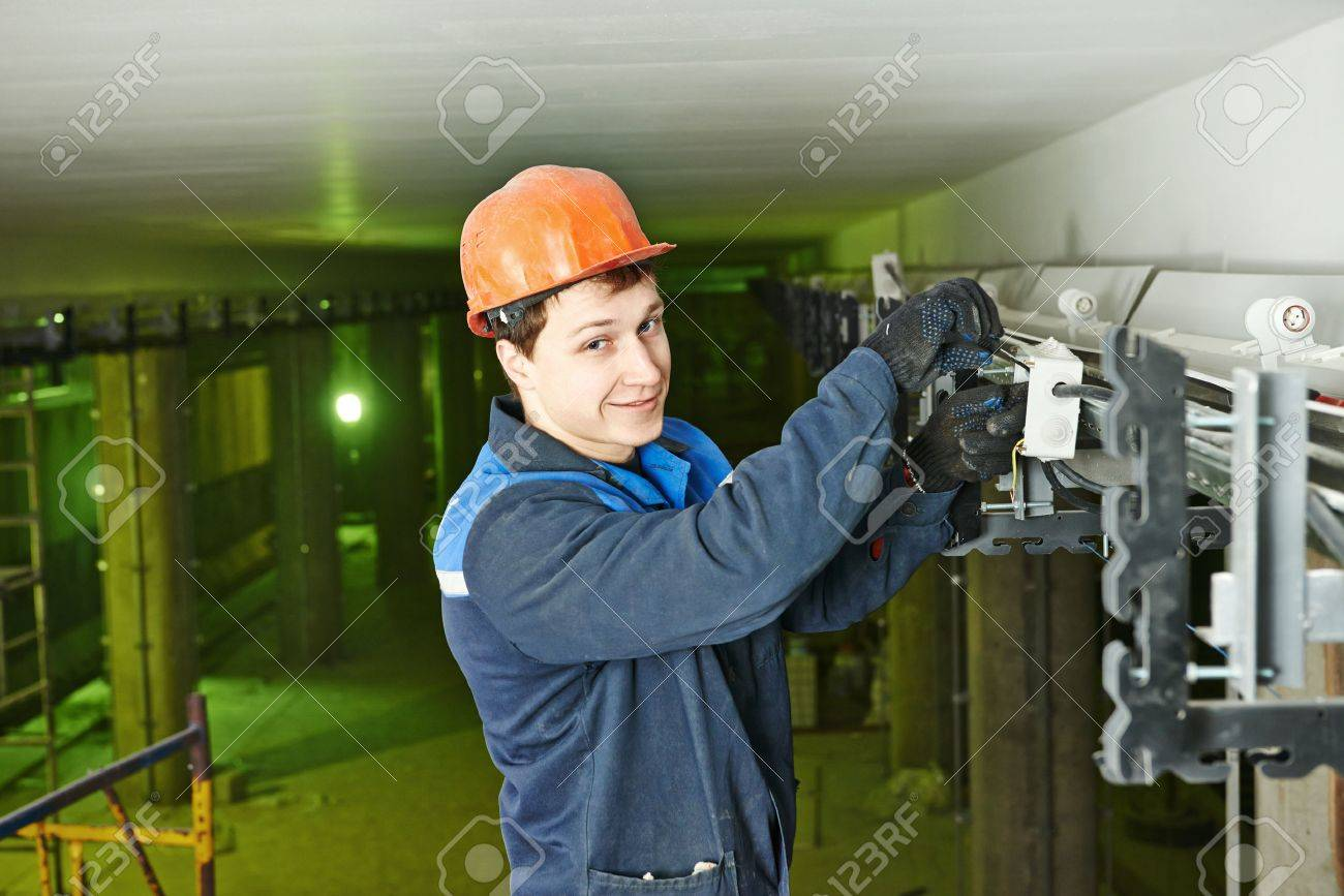 Electrician Builder Engineer Installing Industrial Cable Into Fuse Box Stock Photo 27914338