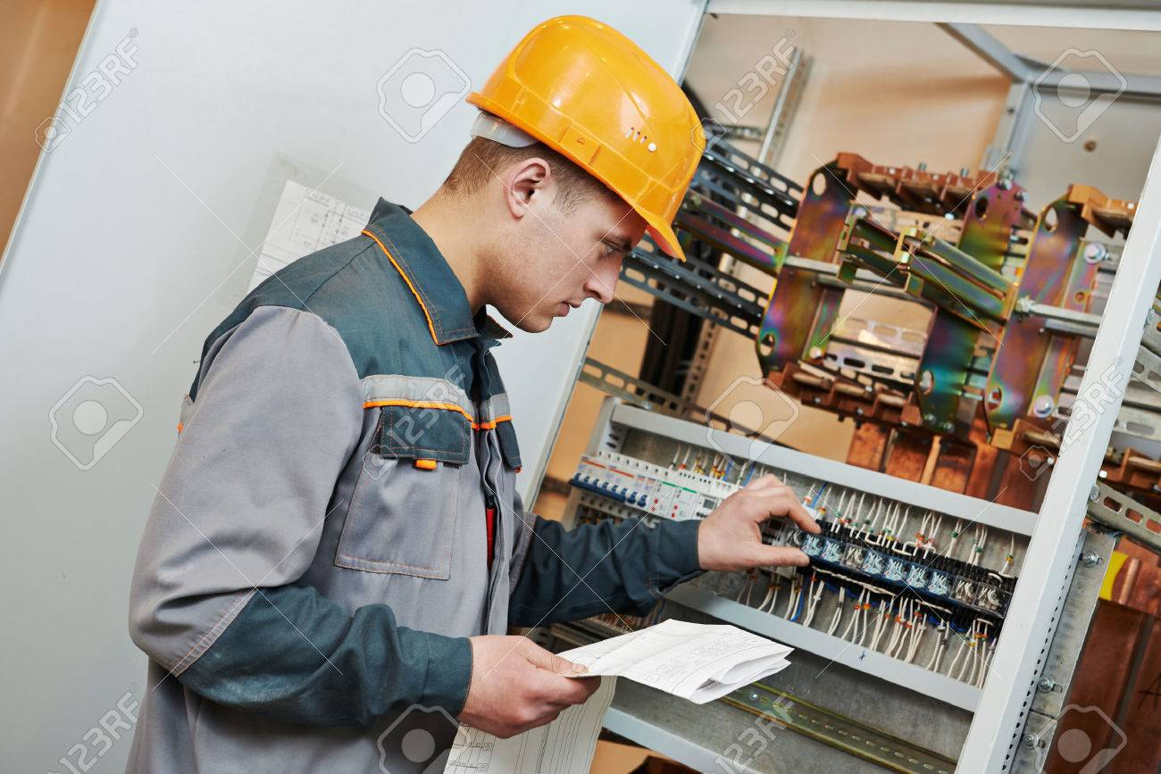 electrician builder engineer blue print scheme project in stock photo electrician builder engineer blue print scheme project in front of fuse switch box