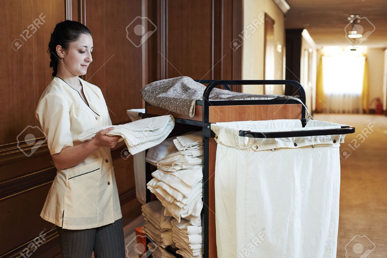 Hotel Room Service. Female Housekeeping Worker With Bedclothes ...