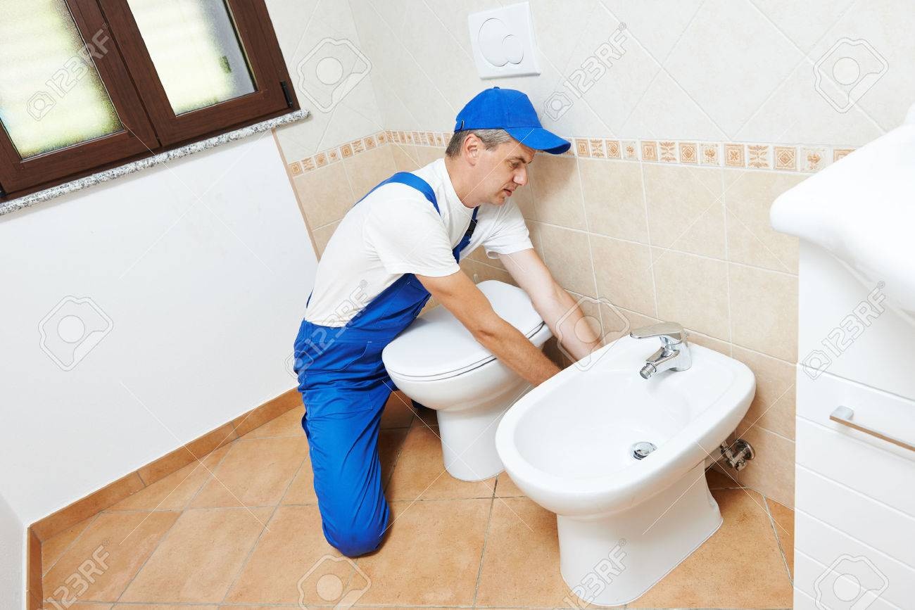 Plumber Worker Working With Spanner At Sanitary Washbasin ...
