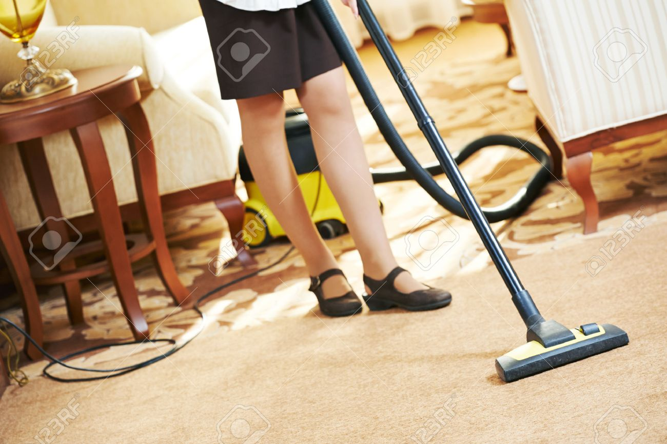 Hotel Service. Female Housekeeping Worker With Vacuum Cleaner In Room  Apartment Stock Photo   31104493