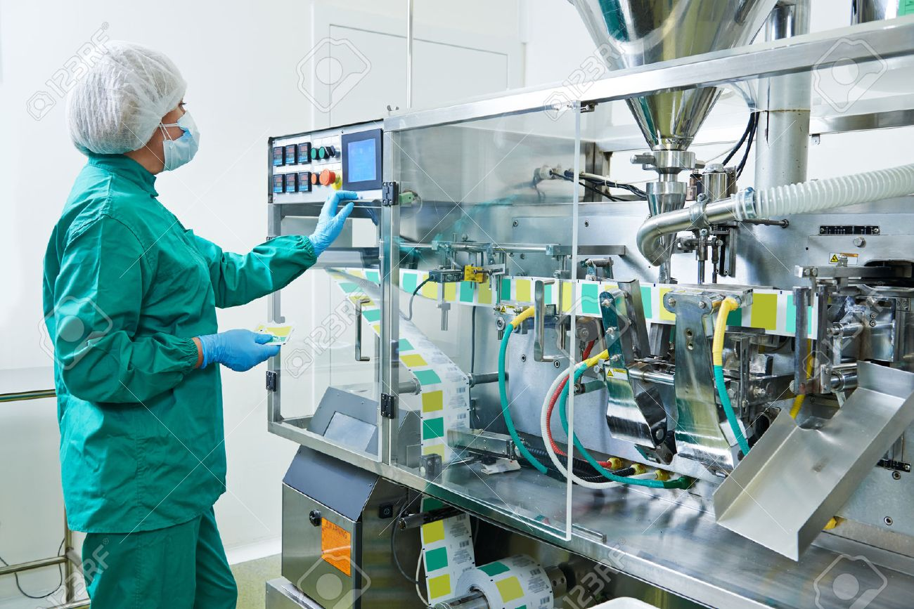 pharmaceutical factory woman worker operating production line at pharmacy industry manufacture factory - 36816443