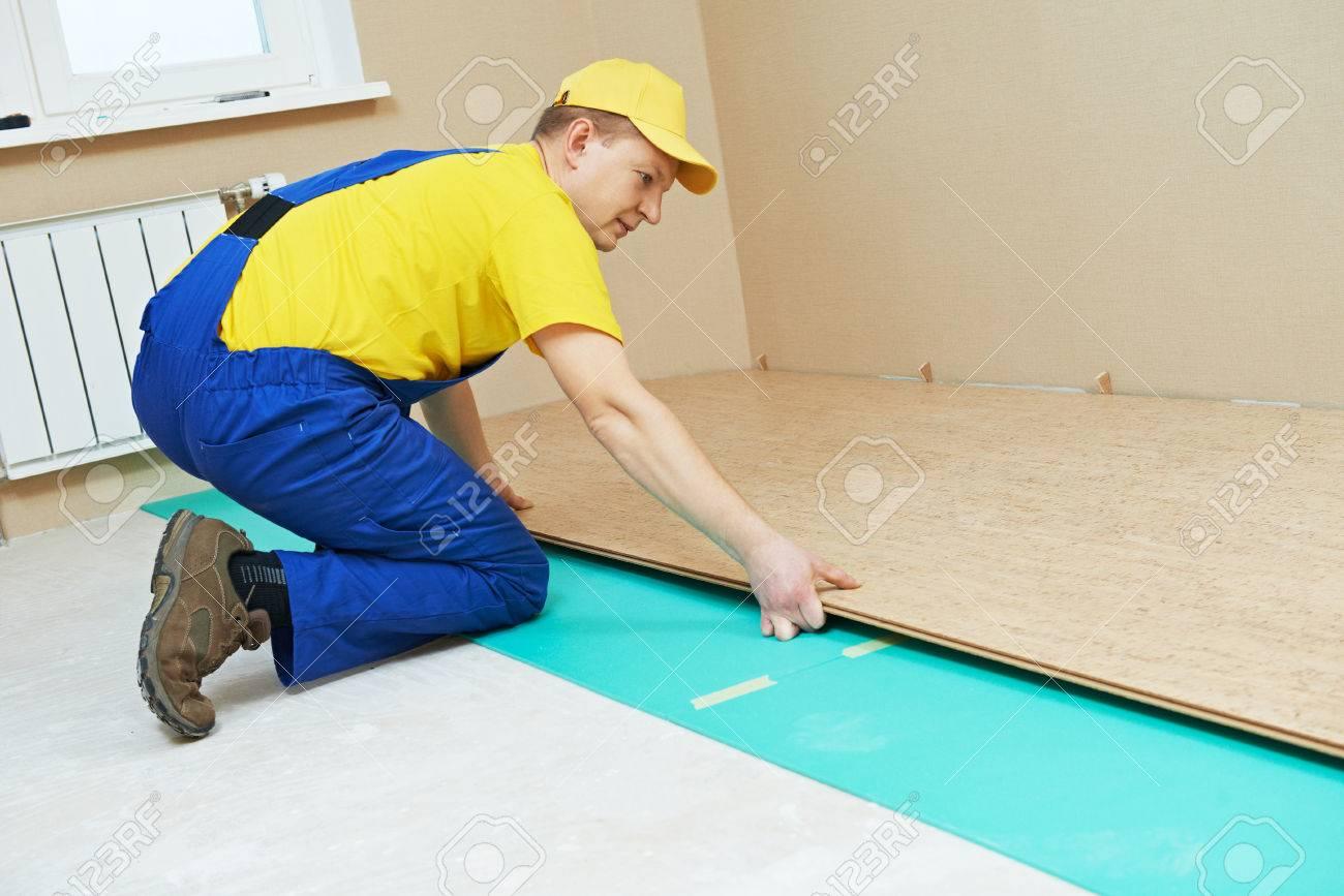 Elegant One Carpenter Worker Laying Cork Boards During Indoors Flooring Work Stock  Photo   37754163