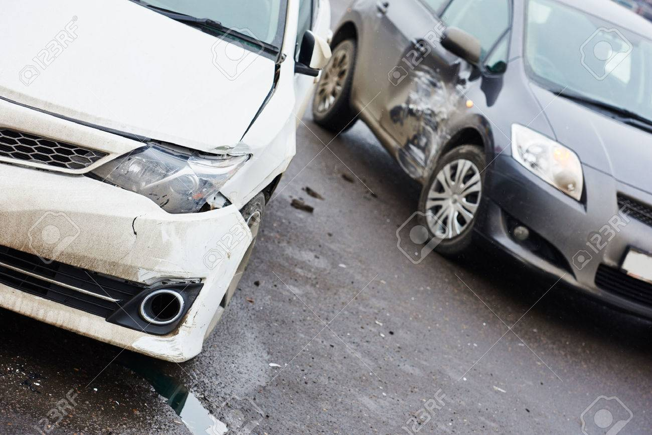 car crash accident on street, damaged automobiles after collision in city - 37783981