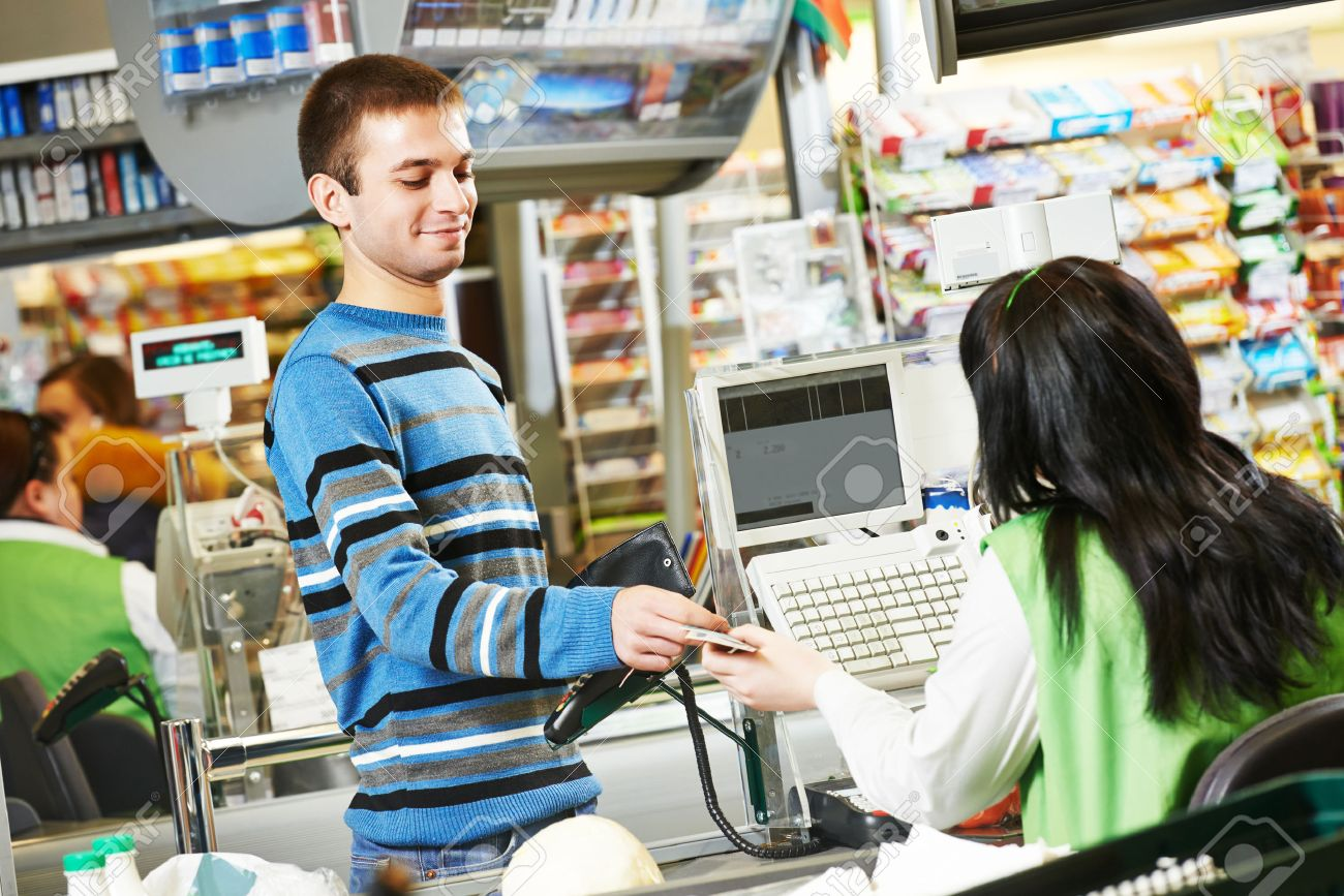 customer buying food at supermarket and making check out customer buying food at supermarket and making check out cashdesk worker in store stock photo