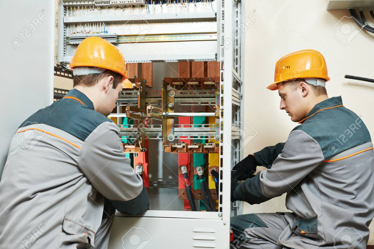 Electrician Builder Engineer Workers With Electric Cable Wiring Contractor Of Fuse Switch Box Stock Photo 39054567