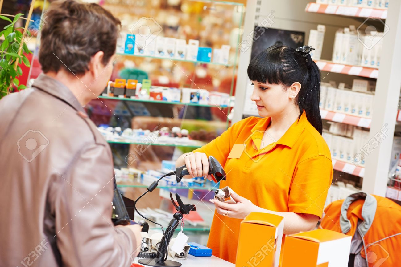 female seller cashier using barcode scanner during selling lamp to purchaser in hardware shopping mall supermarket - 41781859