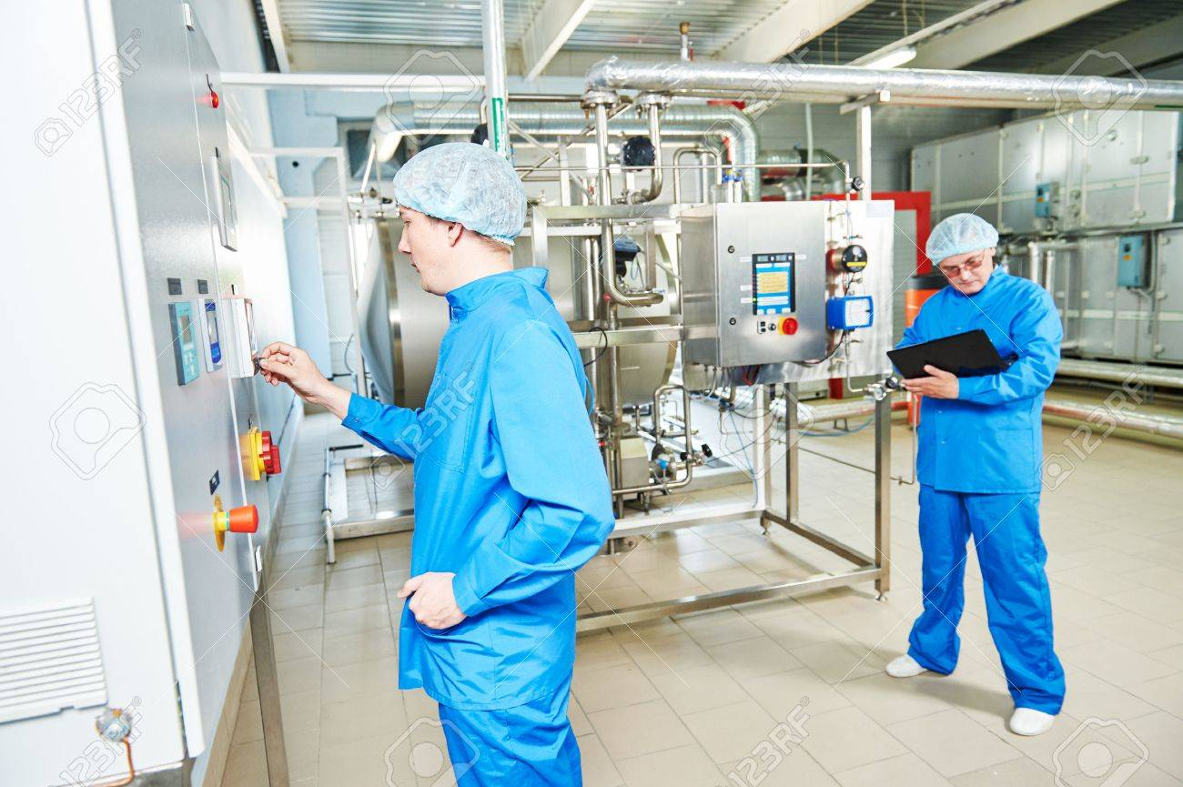 pharmaceutical factory service engineers in water preparation room operating equipment at pharmacy industry manufacture factory Standard-Bild - 58661713