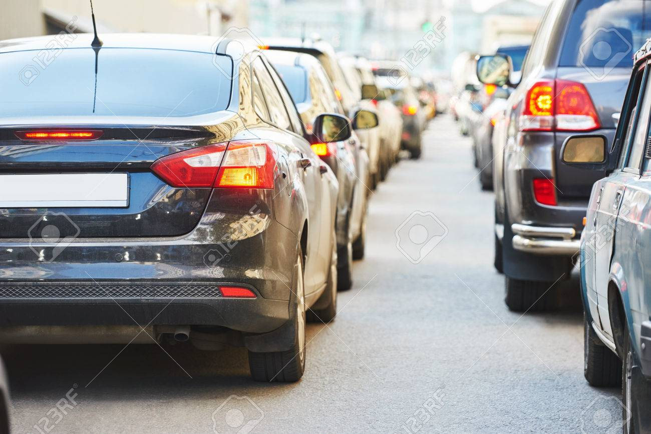 Urban traffic jam with rows of cars in a city street road during rush hour - 48962408