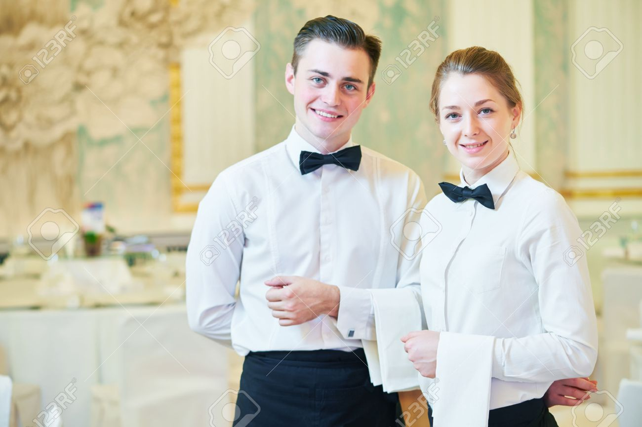 waiter and waitress occupation. Young man and woman at catering service in restaurant during event - 48864853