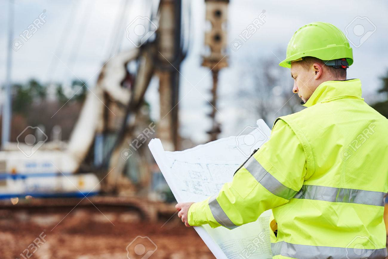 Engineer builder with blueprint plan at construction site stock engineer builder with blueprint plan at construction site stock photo 48864874 malvernweather Image collections