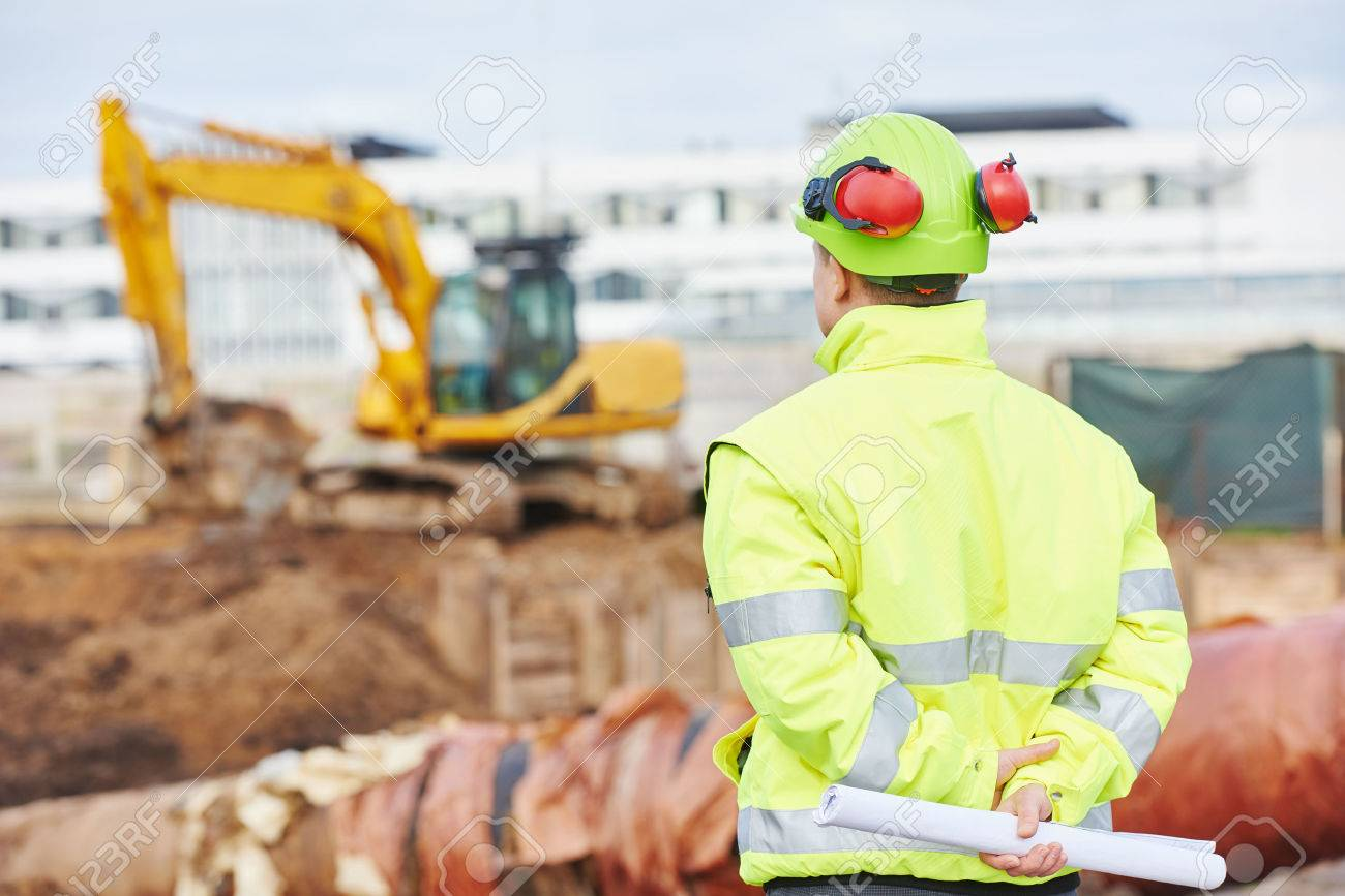 Engineer builder with blueprint plan at construction site stock engineer builder with blueprint plan at construction site stock photo 48864875 malvernweather Gallery