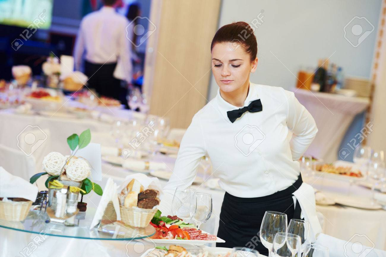 Young Woman With Food On Dishes Servicing In Restaurant During Catering The  Event  Catering Manager