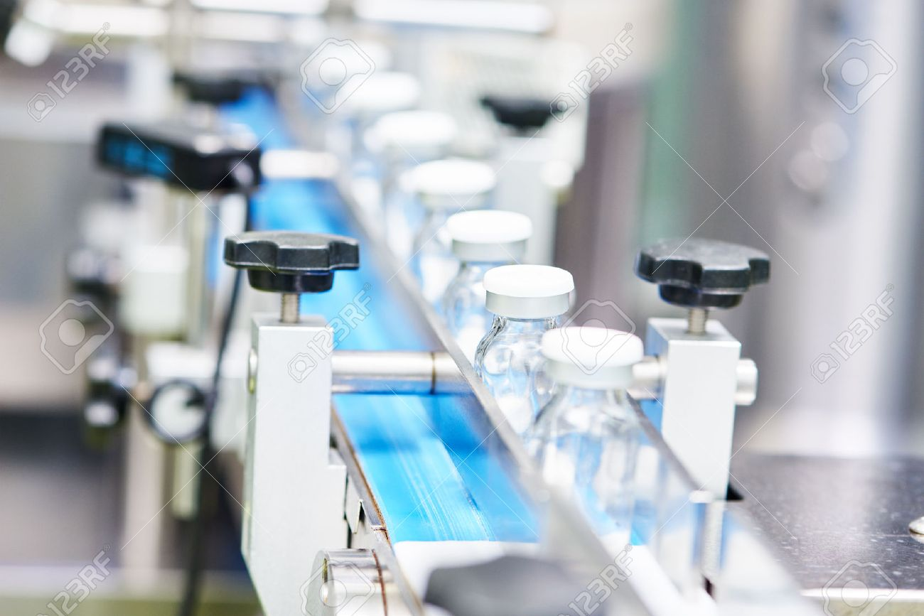 pharmaceutical industry. Production line machine conveyor with glass bottles ampoules at factory, Shallow DOF - 50038101