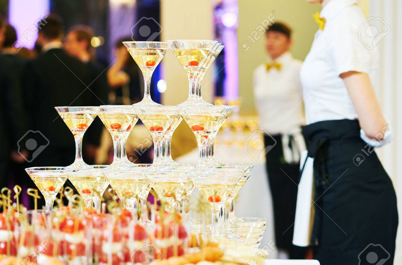 Champagne pyramid with waitress on event, party or wedding banquet reception - 50038108