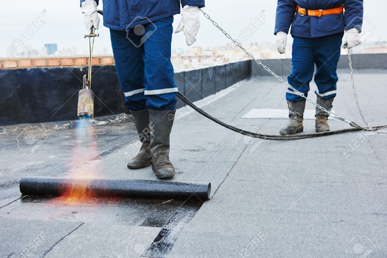 Superb Flat Roof Installation. Heating And Melting Bitumen Roofing Felt By Flame  Torch At Construction Site