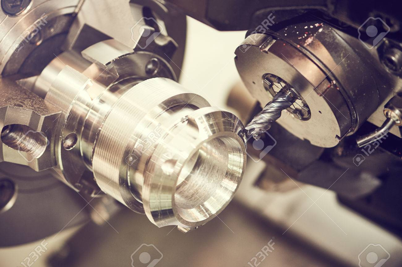metalworking machining cutting process of blank detail by milling cutter with hardmetal carbide insert at modern cnc machine. Toned Stock Photo - 56626851