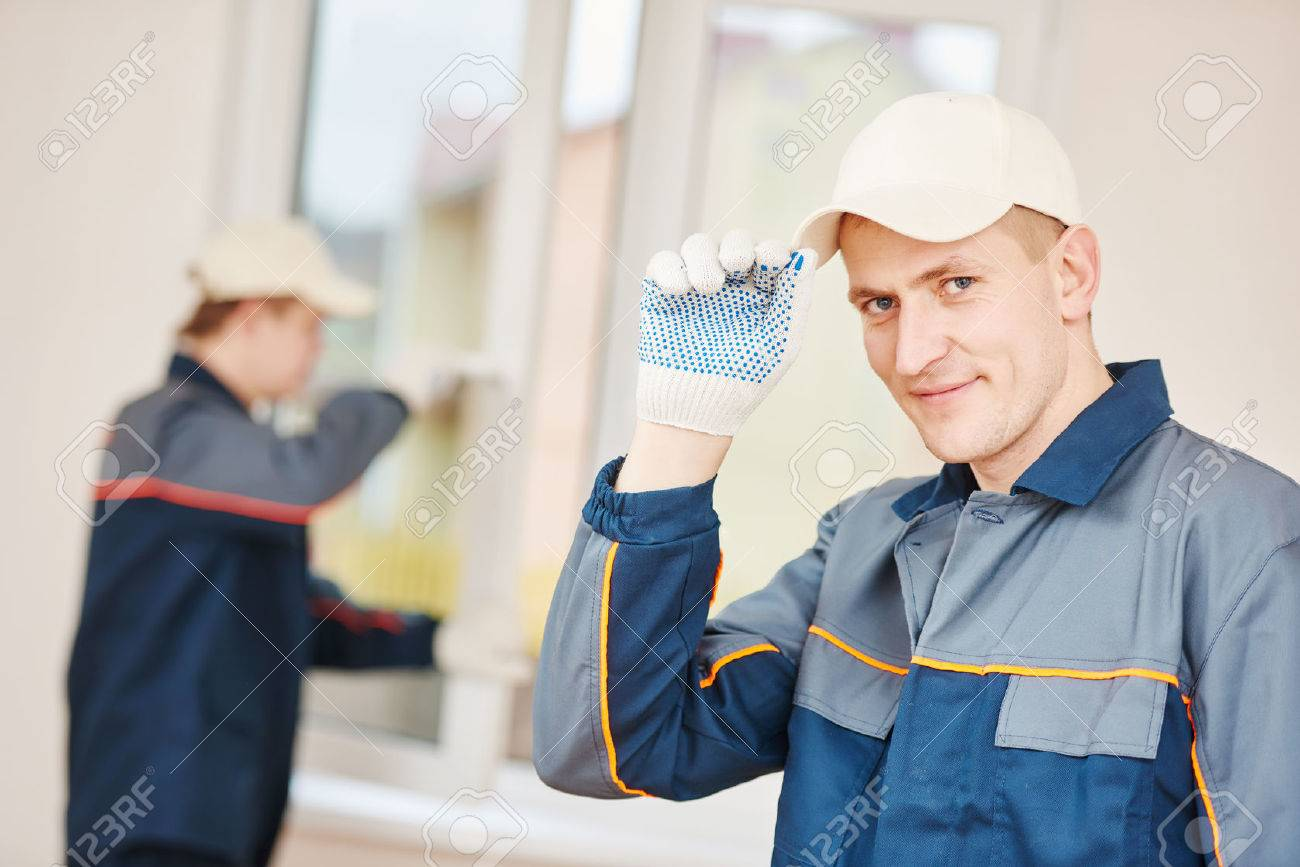 Portrait of construction worker glazier in front of glass window installation indoor Stock Photo - 55569293
