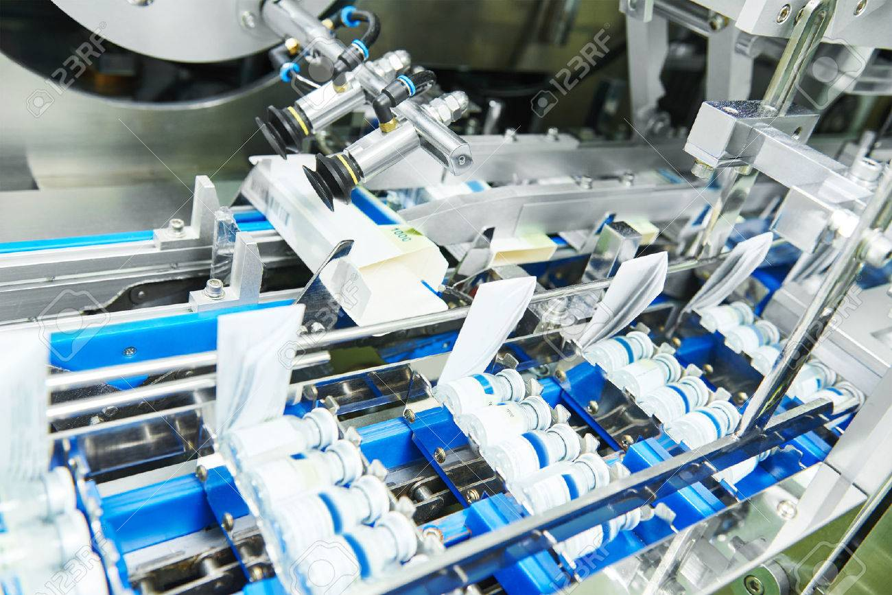 pharmaceutical industry. Line machine conveyer for packaging glass bottles ampoules in boxes at  factory Stock Photo - 56630798