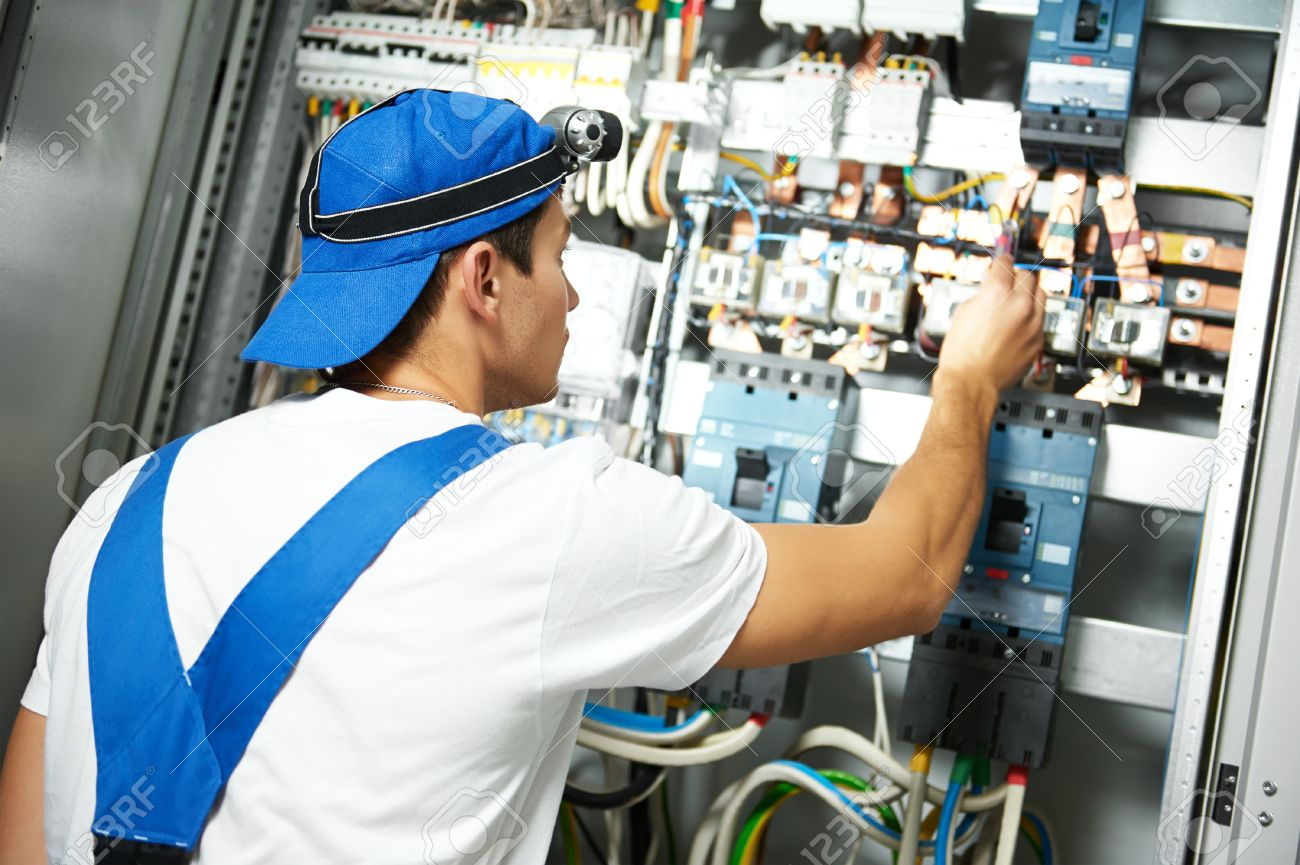 Good Electrician Measure High Voltage With Electrical Tester Meter In Fuse Box  Stock Photo   55593241