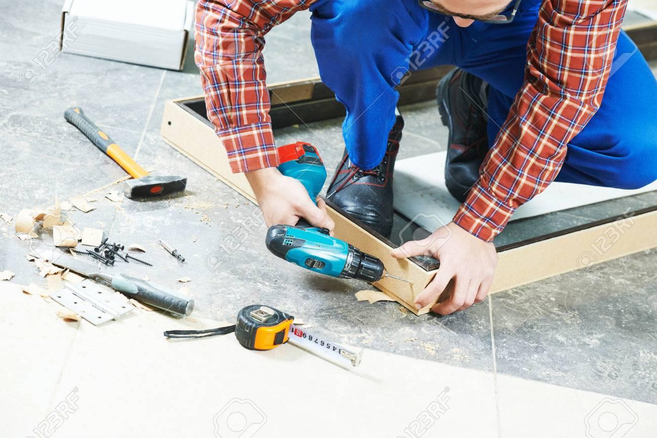 Carpenter Joiner Worker Preparing Door Frame For Indoor Installation ...