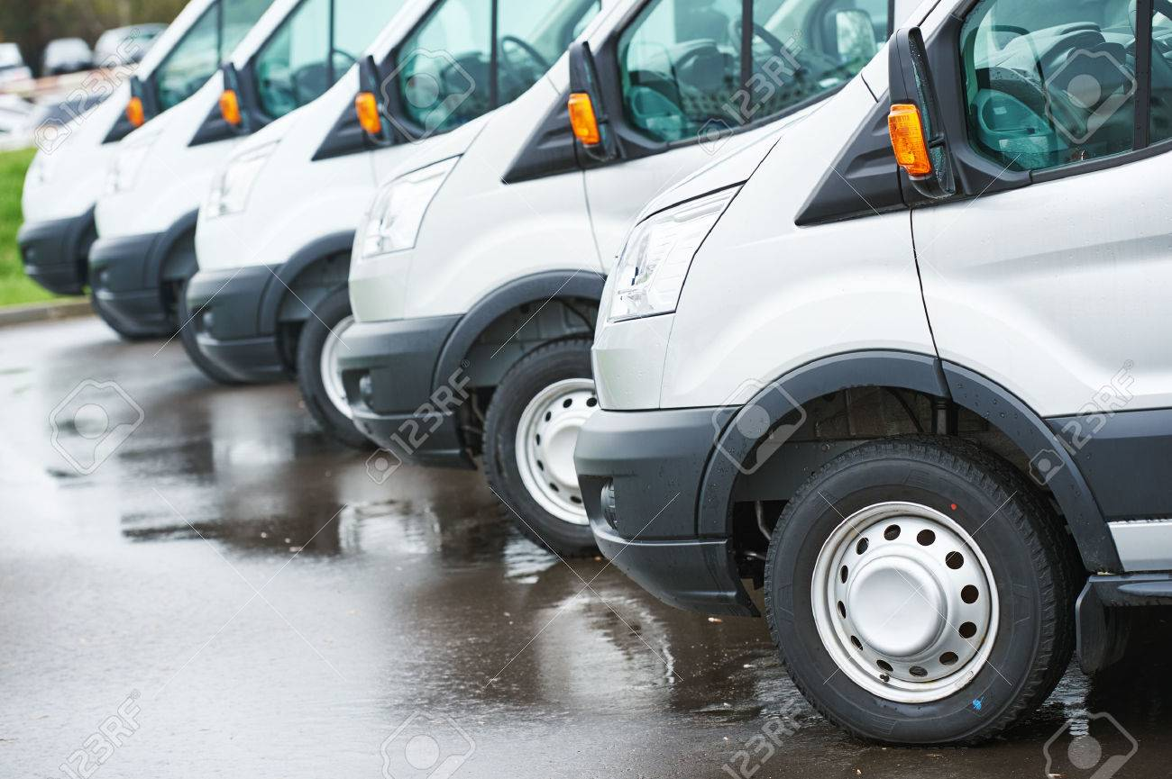 freight services. commercial delivery vans in row at transporting carrier shipping service company parking - 56630864