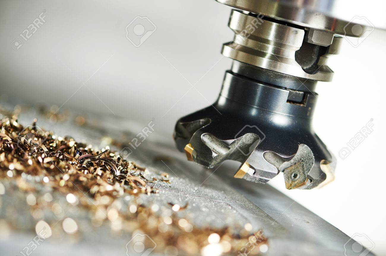 industrial metalworking machining cutting process of blank detail by milling cutter with hardmetal carbide insert at modern cnc machine. Standard-Bild - 56634028