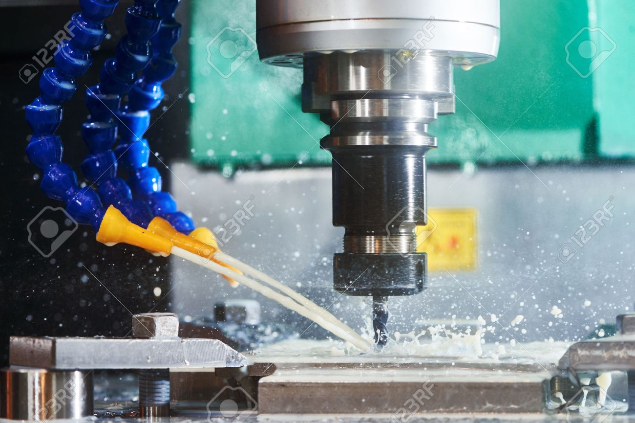 Milling metalworking process. Precision industrial CNC machining of metal detail by cutting mill at factory Standard-Bild - 57363011