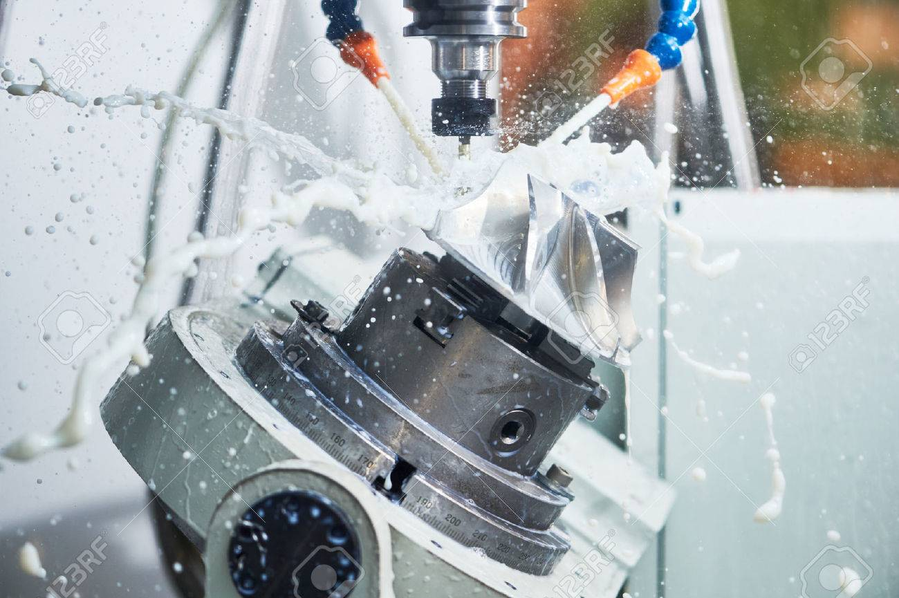 Milling metalworking process. Industrial CNC machining of metal detail by cutting end-tooth vertical mill at factory Standard-Bild - 60248317