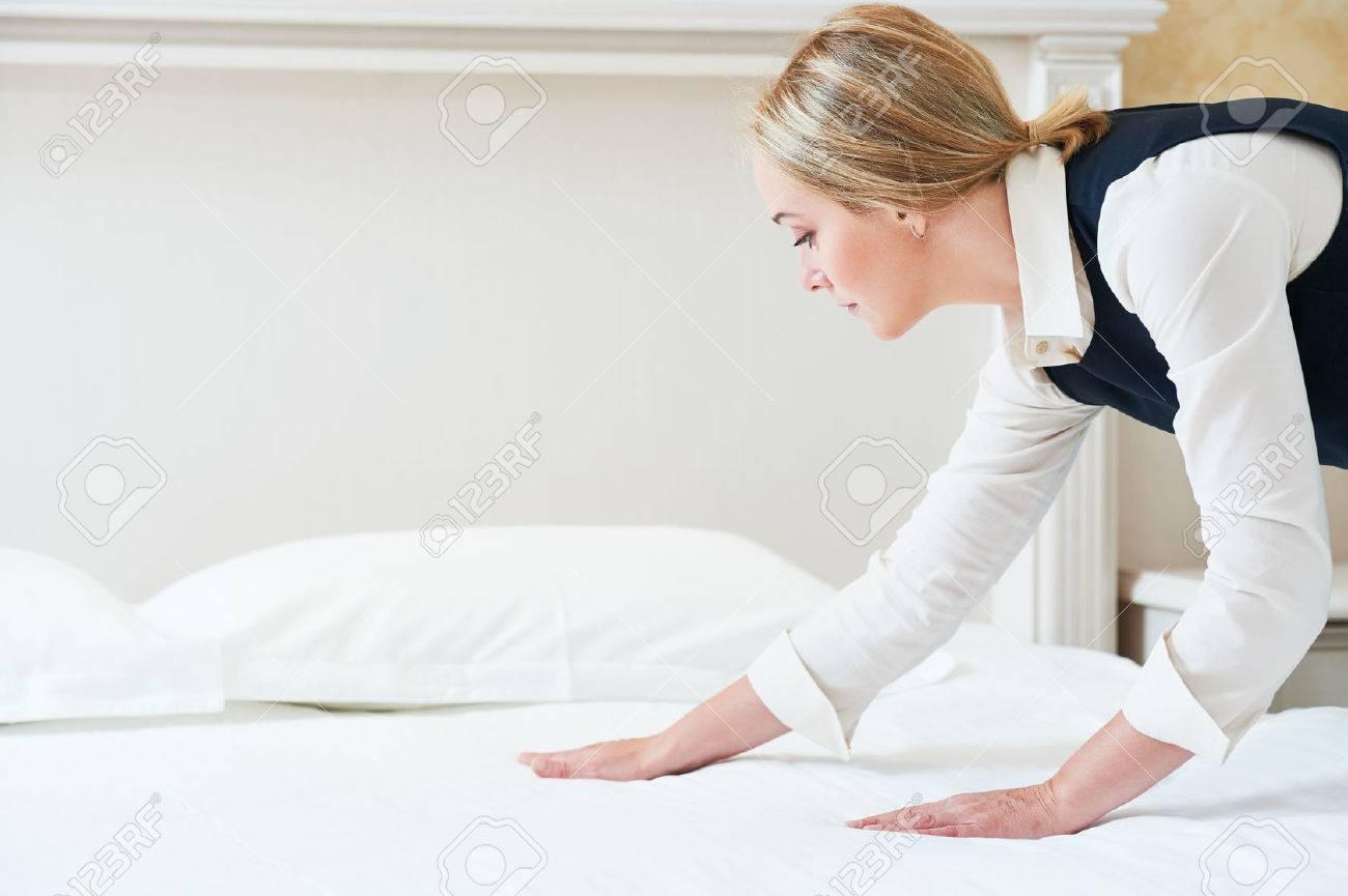 Hotel service. Made making bed linen in room Standard-Bild - 60799382