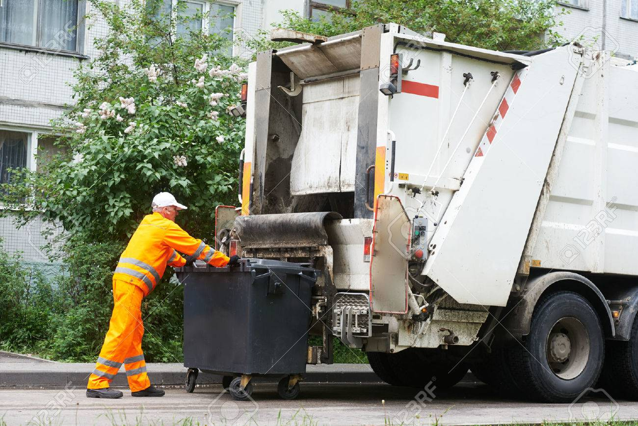 Worker Of Urban Municipal Recycling Garbage Collector Truck Loading.. Stock  Photo, Picture And Royalty Free Image. Image 65396604.