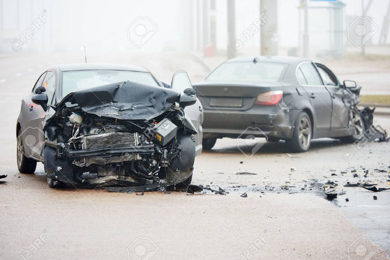 Car crash accident on street with wreck and damaged automobiles after collision Stock Photo - 65841020