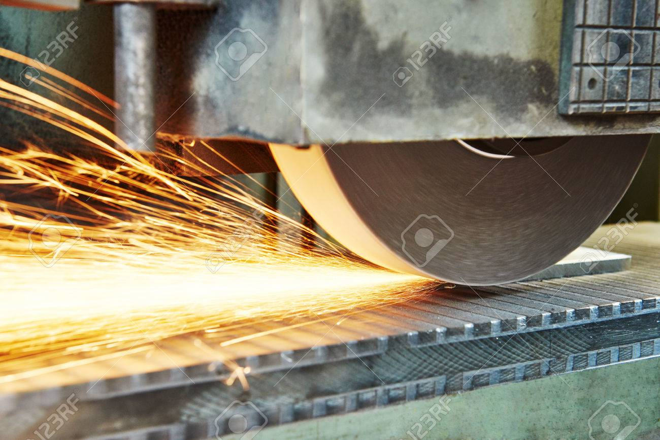 metalworking machining industry. finishing or grinding metal surface on horizontal grinder machine at factory Stock Photo - 65192977