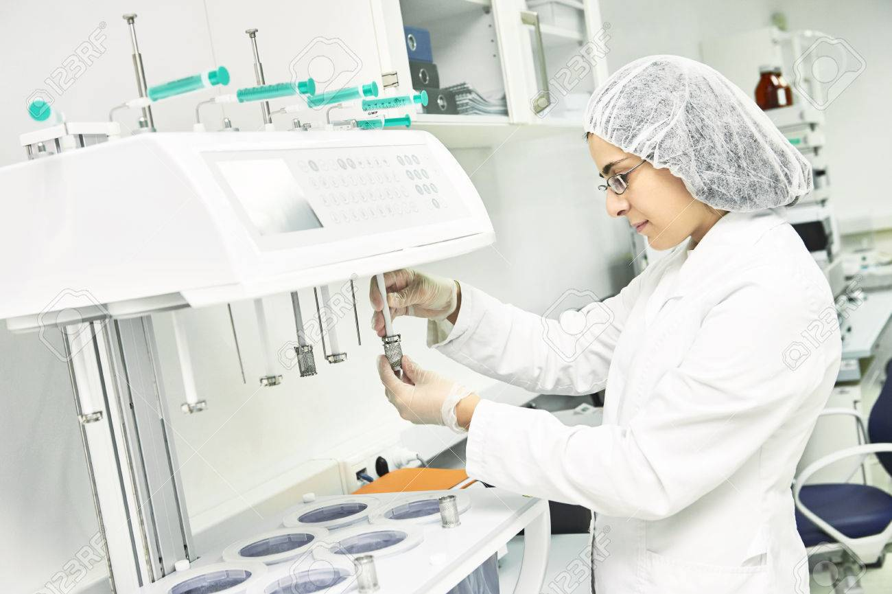 Pharmaceutical researcher making dissolution test - 68575659