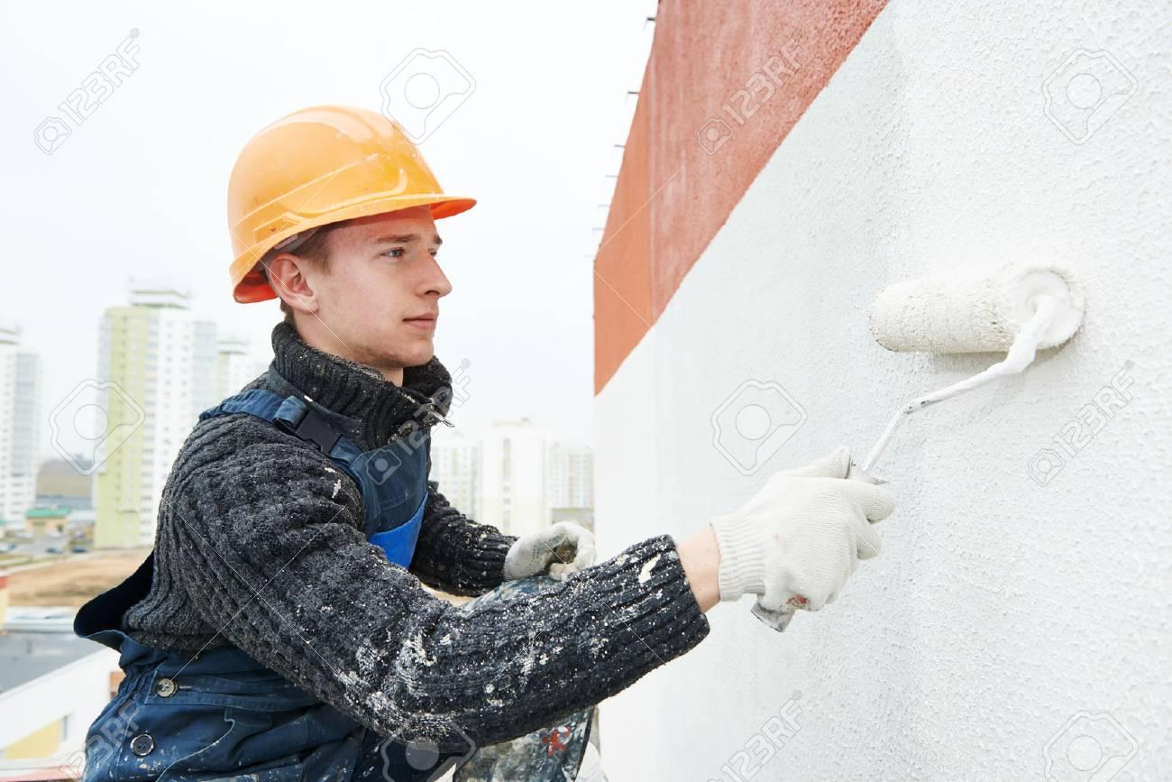 builder facade painter at work - 70440981