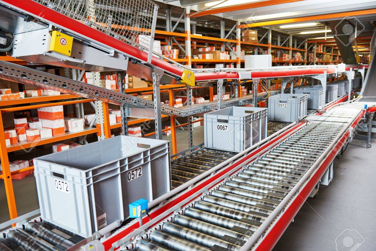 Automated warehouse. Boxes with spare parts moving on conveyer Standard-Bild - 71778359