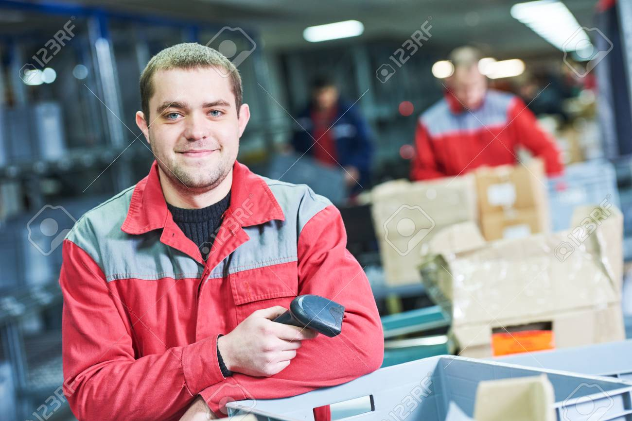 worker with barcode scanner at warehouse - 71388363