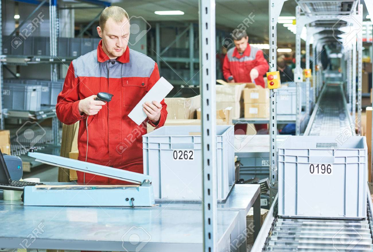 worker with laser barcode scanner at warehouse - 71385036