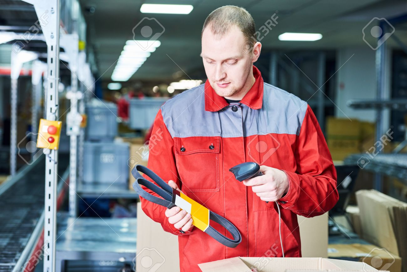 worker man working with laser barcode scanner at automobile spare part warehouse - 74831817