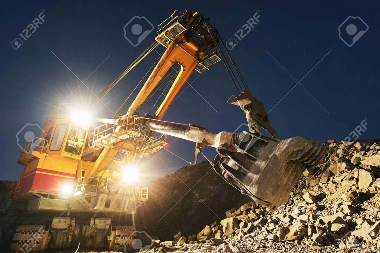 Mining construction industry. Excavator digging granite or ore in quarry - 77656317