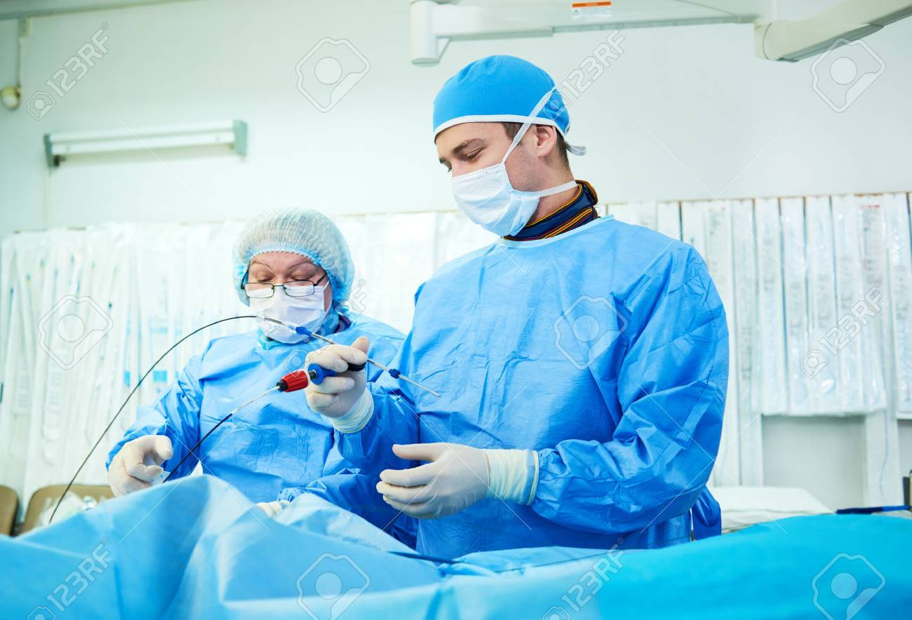 Interventional cardiology. Male surgeon doctor at operation - 77656330
