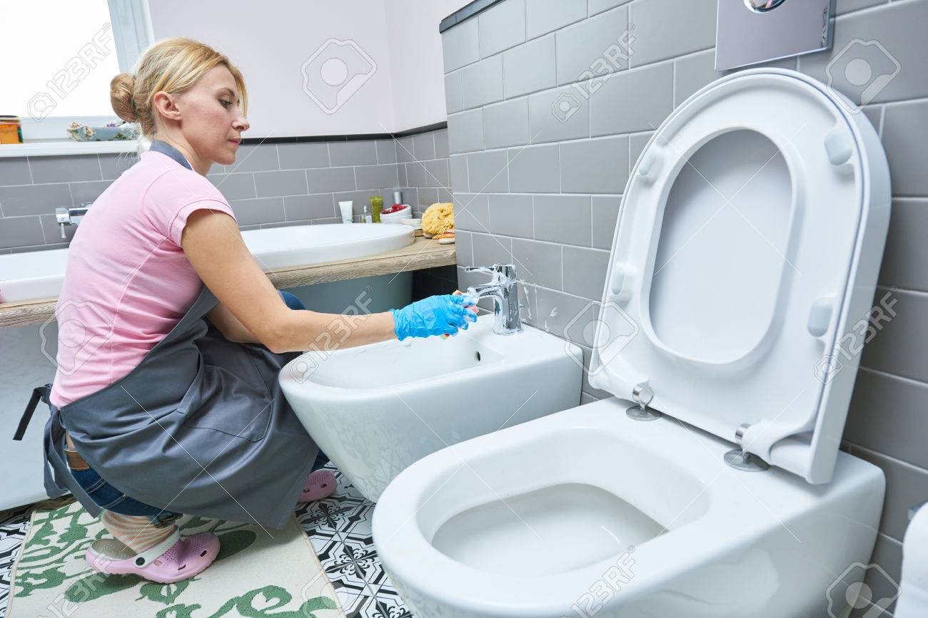Cleaning Service. Woman Clean Toilet Sink Stock Photo, Picture And ...
