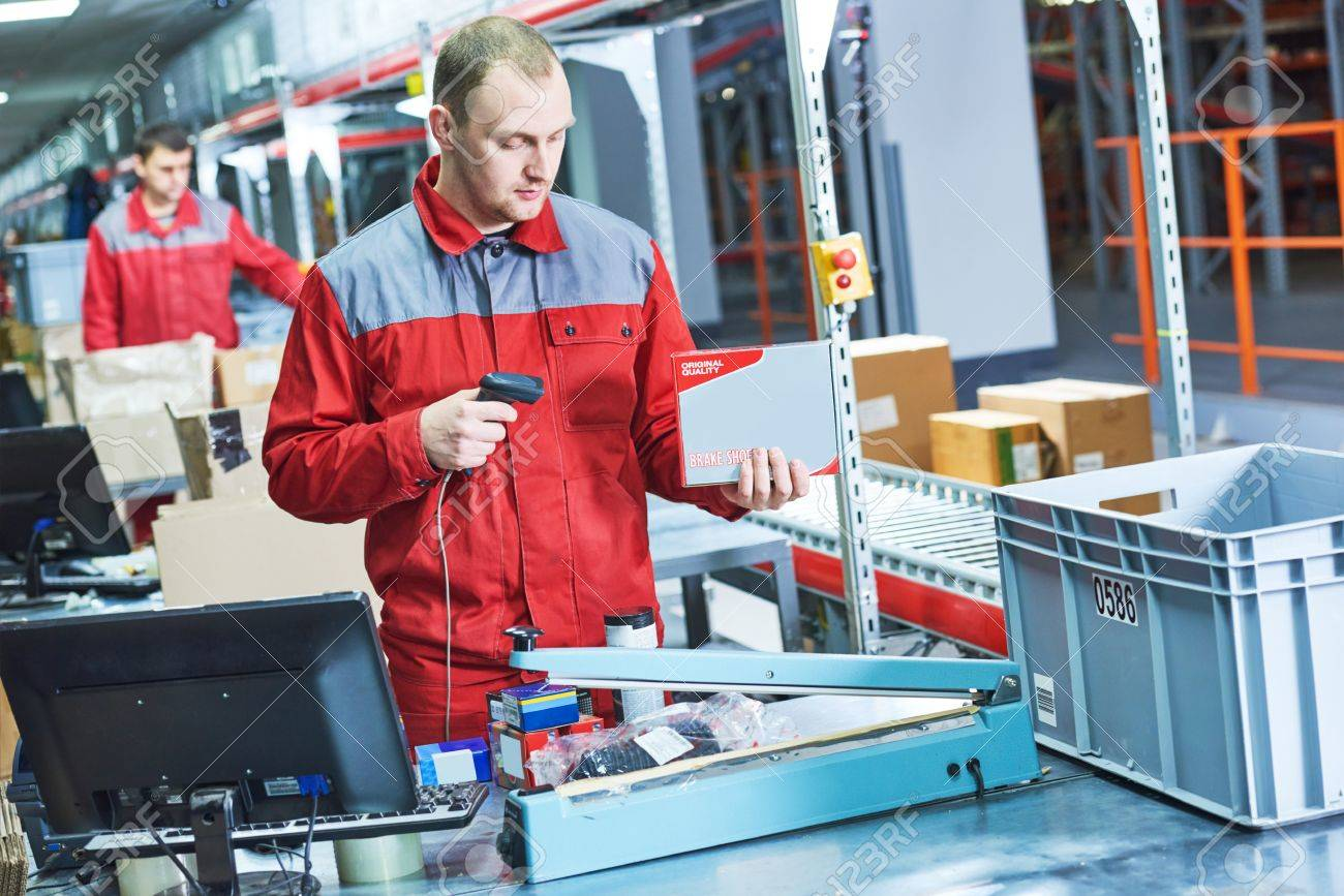 worker with laser barcode scanner at warehouse - 78508909
