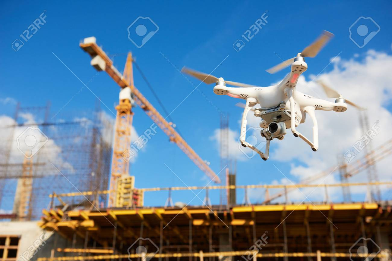 Drone hovering over construction site. video surveillance or industrial inspection - 82998288