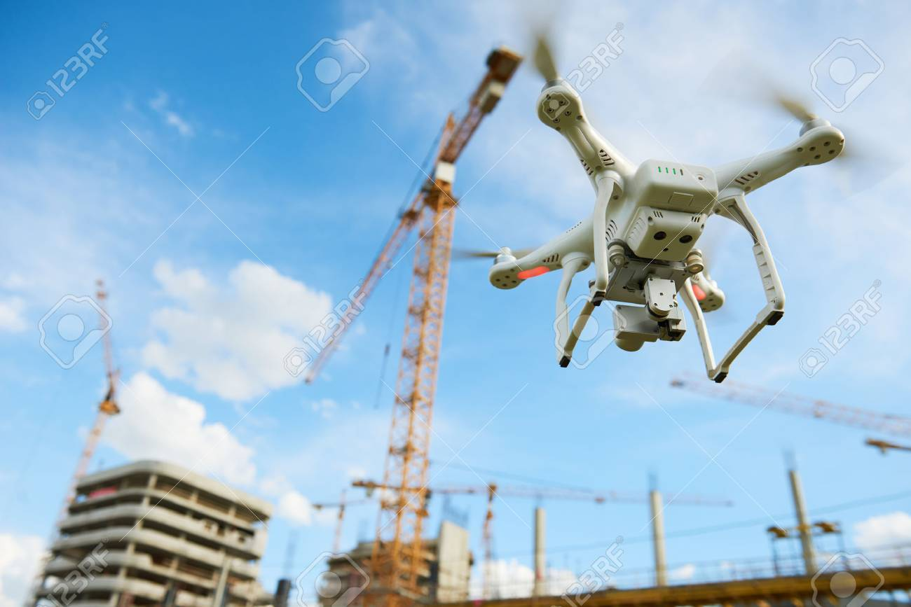 Drone over construction site. video surveillance or industrial inspection - 84484241