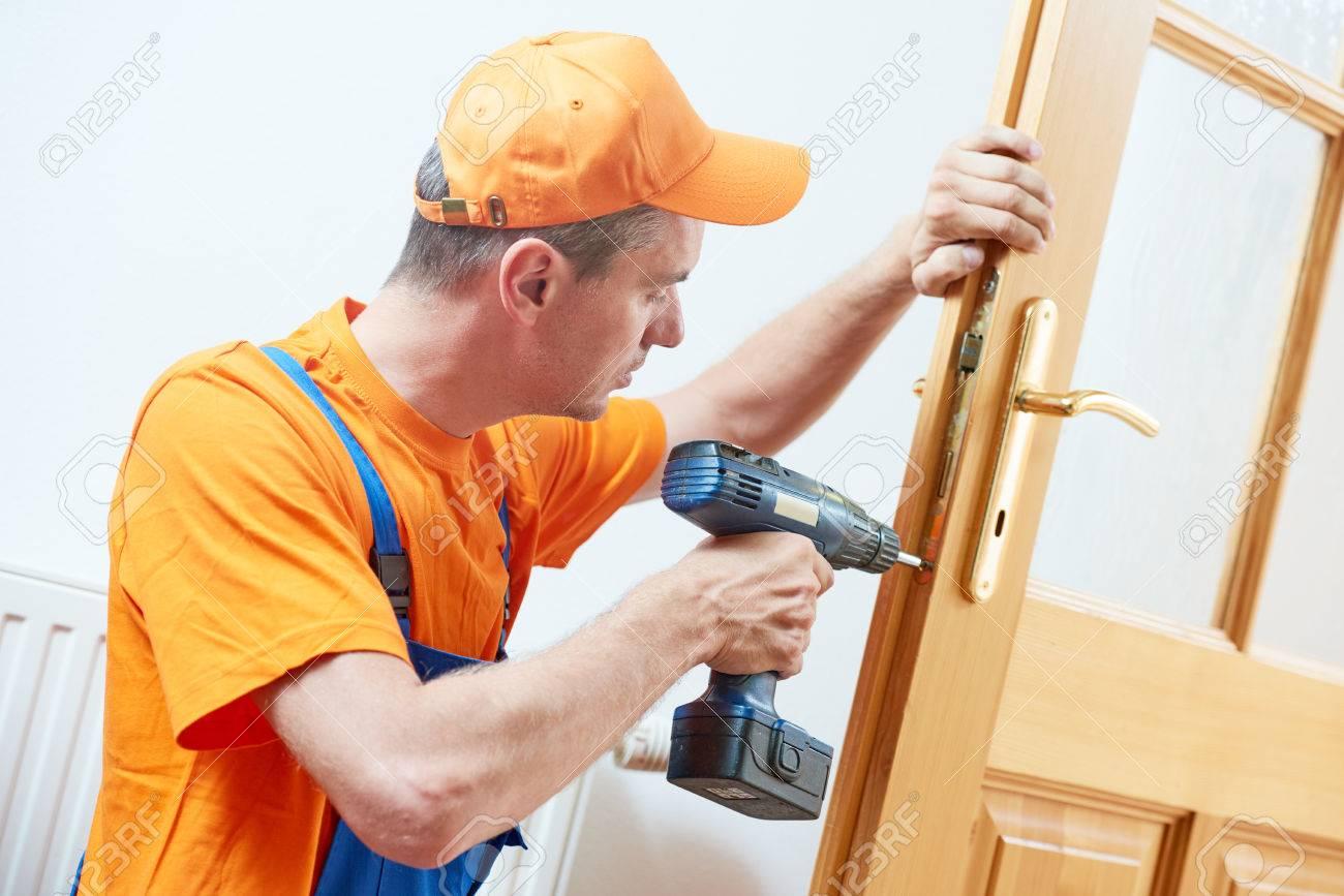 carpenter at door lock installation or repair - 83804436