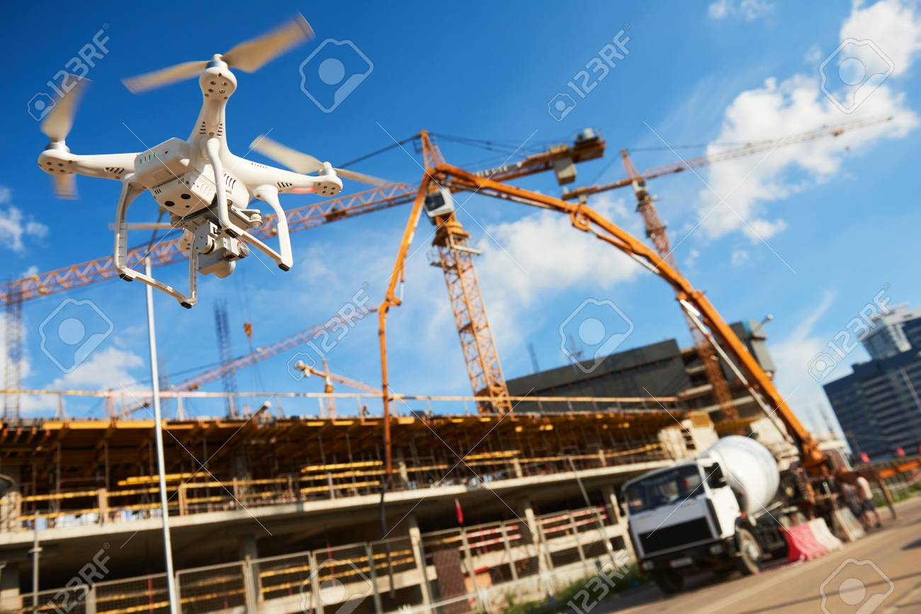 Drone over construction site. video surveillance or industrial inspection - 86566881